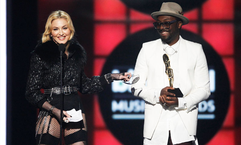 "Singer Madonna accepts the award for ""Top Touring Artist"" presented to her by musician Will.i.am (R), during the Billboard Music Awards at the MGM Grand Garden Arena in Las Vegas. —Reuters Photo"