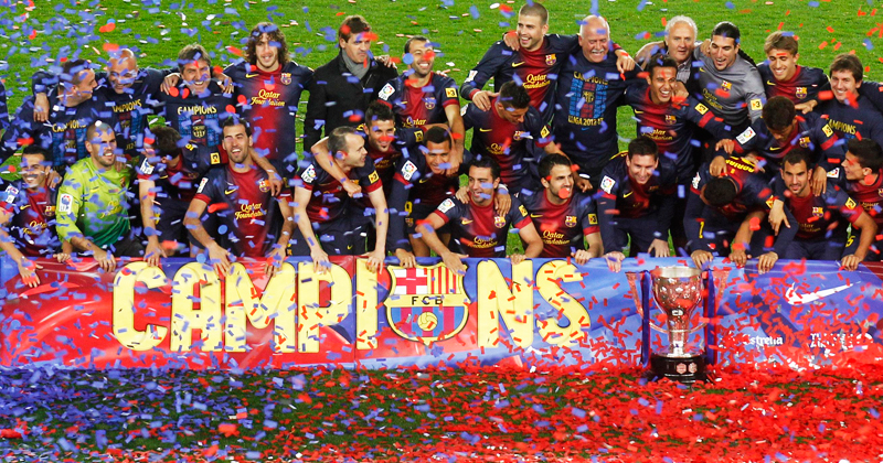 Barcelona's players pose with the trophy. -Photo by Reuters