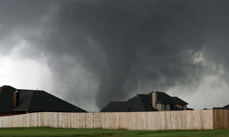 A tornado moves past homes in Moore, Okla. on Monday, May 20, 2013. — Photo AP