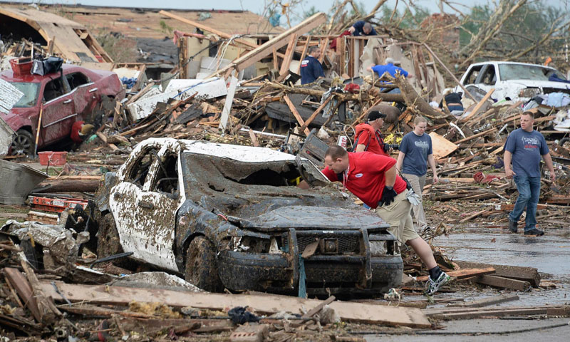 A damaged police car is seen after a tornado struck Moore, Oklahoma, May 20, 2013. — Photo by Reuters