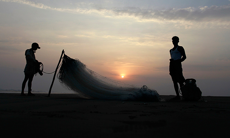 Men from a Rohingya internally displaced persons (IDP) camp prepare to fish along a beach near their camp, outside of Sittwe, May 18, 2013.  — Reuters Photo