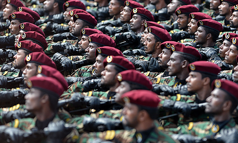Sri Lankan commandos march during a Victory Day parade in Colombo on May 18, 2013. Sri Lanka celebrates War Heroes month with the parade which celebrates the fourth anniversary of the military defeat of the Tamil Tiger rebels in May 2009, ending a 37-year long separatist conflict. — AFP Photo