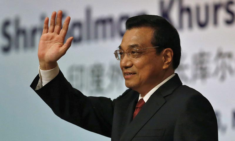 Chinese Premier Li Keqiang waves to the audience during an event organised by Indian Council of World Affairs (ICWA) in New Delhi May 21, 2013. — Photo Reuters