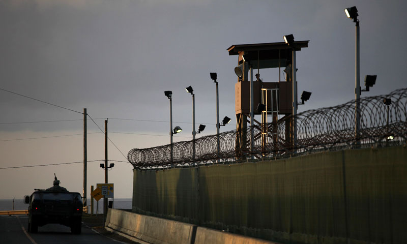 A guard looks out from a tower at the detention facility of Guantanamo Bay US Naval Base in Cuba. —AP (File) Photo