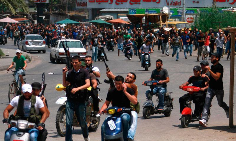 Lebanese Sunni gunmen ride on motorcycles during the funeral of one of their colleagues in Lebanon's northern city of Tripoli, May 20, 2013. — Photo by Reuters