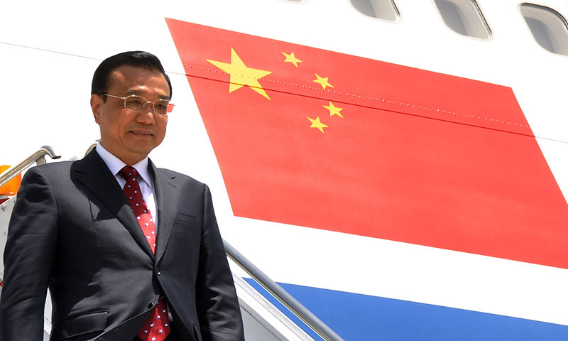 Chinese Premier Li Keqiang steps down from his plane upon arrival at Pakistan's Nur Khan air base in Rawalpindi on May 22, 2013. — Photo by AFP
