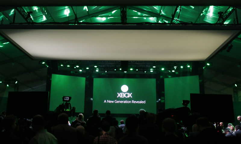 Members of the media are seen inside a tent during a press event unveiling Microsoft's new Xbox in Redmond,  WA. — Reuters Photo