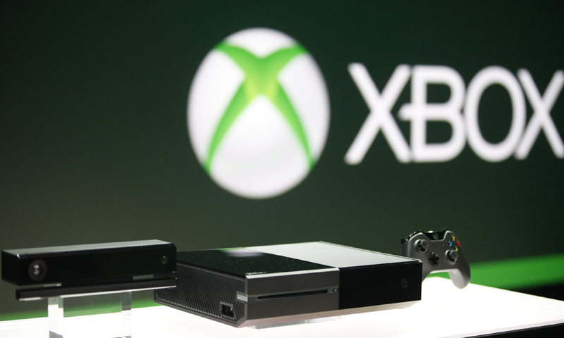 Xbox One (C) with the Kinect motions sensor (L) and the controller is pictured during a press event unveiling. — Reuters Photo