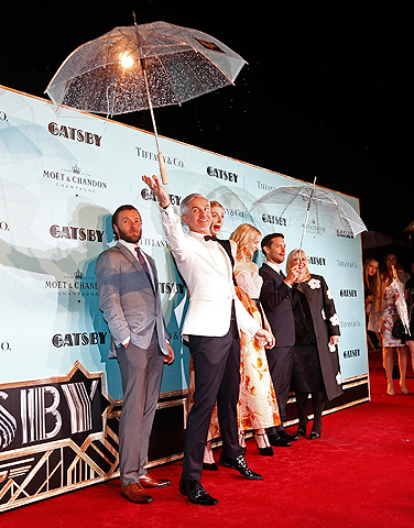 "Director Baz Luhrmann (2nd L) throws an umbrella as the cast pose for pictures on the red carpet of the Australian premiere of ""The Great Gatsby"" in Sydney May 22, 2013. — Reuters Photo"