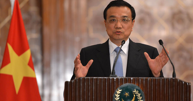 Chinese Premier Li Keqiang gestures during a joint press conference with unseen Pakistani President Asif Ali Zardari at the presidential palace in Islamabad on May 22, 2013. – AFP Photo