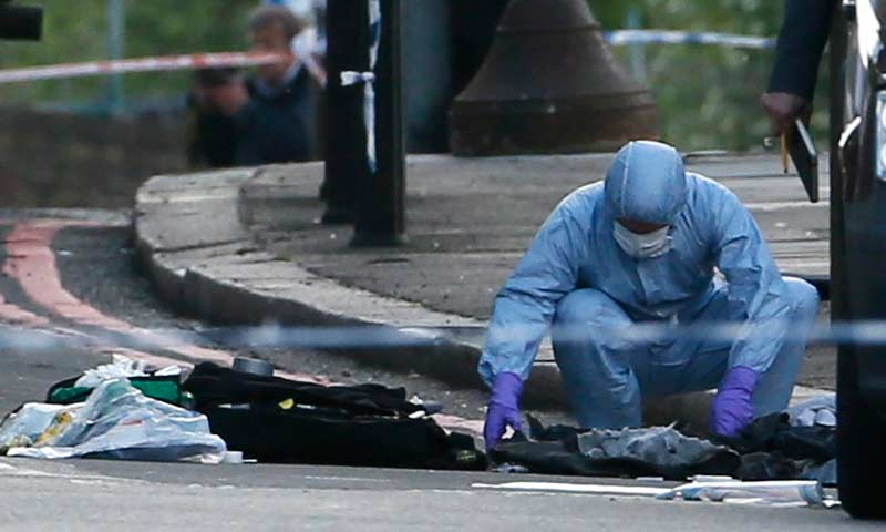 A police forensics officer investigates a crime scene where one man was killed in Woolwich, southeast London. -Reuters Photo