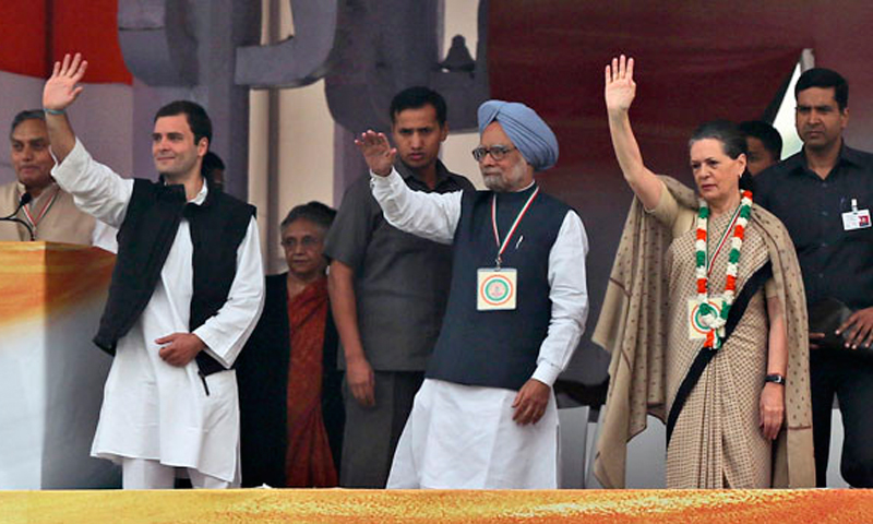 Indian Prime Minister Manmohan Singh (L) and Congress Party General Secretary Rahul Gandhi (R) gesture as Congress President and UPA Chairperson Sonia Gandhi (C) waves towards supporters during a party rally at The Ram Lila Grounds in New Delhi on November 4, 2012. –AFP Photo