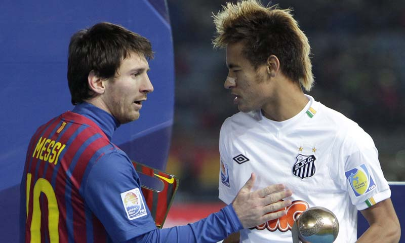 In this Dec.18, 2011 file photo, Spain's FC Barcelona midfielder Lionel Messi, left, and Brazil's Santos FC forward Neymar congratulate at each other during an award ceremony at the Club World Cup soccer tournament in Yokohama, near Tokyo, Japan. Neymar announced Saturday May 25, 2013 he has made up his mind and will be joining Barcelona after the upcoming Confederations Cup. — File Photo by AP