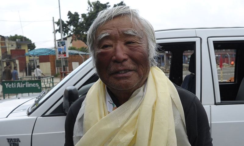 Japanese adventurer Yuichiro Miura walks upon his arrival at Tribhuvan Airport in Kathmandu on May 26, 2013, after summitting Mount Everest.Muria, 80, underwent heart surgery in January and reached the summit of Mount Everest on May 23, becoming the oldest person to scale the world's highest mountain with his second son Gouta, joining him.—Photo by AFP
