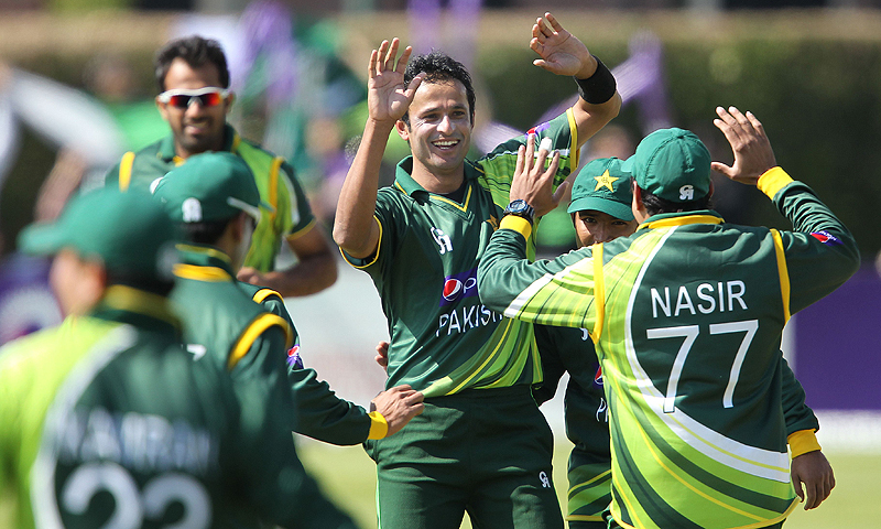 Pakistan's Asad Ali (C) celebrates with teammates after taking the wicket of Ireland's William Porterfield (not pictured). -Photo by AFP