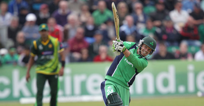 Ireland's Ed Joyce hits a shot for his century during the second One Day International (ODI) cricket match between Pakistan and Ireland at Clontarf Cricket Club in Dublin on May 26, 2013. –AFP Photo