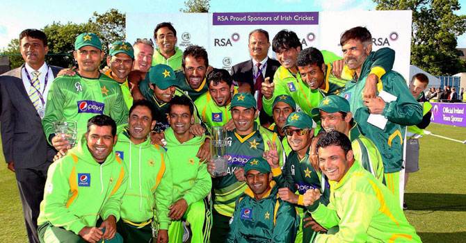 Pakistan's captain Misbah-ul-Haq holds the trophy as he poses with the team for a photograph after defeating Ireland in the second One Day International (ODI) cricket match between Pakistan and Ireland at Clontarf Cricket Club in Dublin on May 26, 2013. – AFP Photo