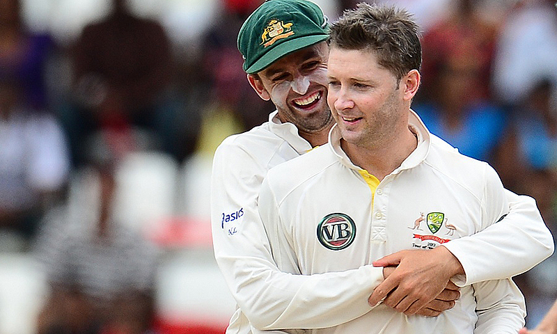 Nathan Lyon and Michael Clarke. -Photo by AFP