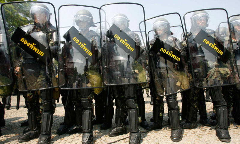 The image shows Thai riot soldiers holding army shields during a practice at the Government House in Bangkok. — File photo