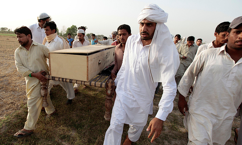 People carry the coffin of one of 14 children who died after a gas cylinder exploded on a school bus, during their funeral. — Reuters Photo