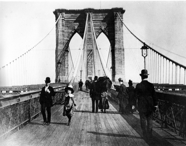 Walking across the Brooklyn Bridge Pedestrians stroll across the Brooklyn Bridge, which connects Manhattan to Brooklyn, in 1891. The design of the bridge purposefully incorporated a promenade.— AP Photo
