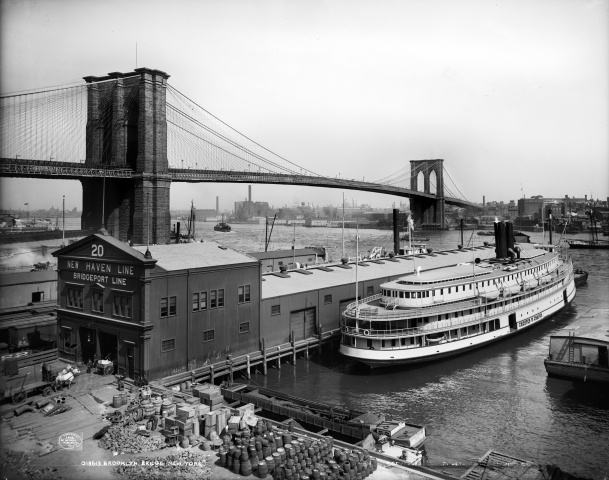 The steamboat Chester W. Chapin docks at a pier in the East River near the Brooklyn Bridge in New York, ca. 1905.— AP Photo