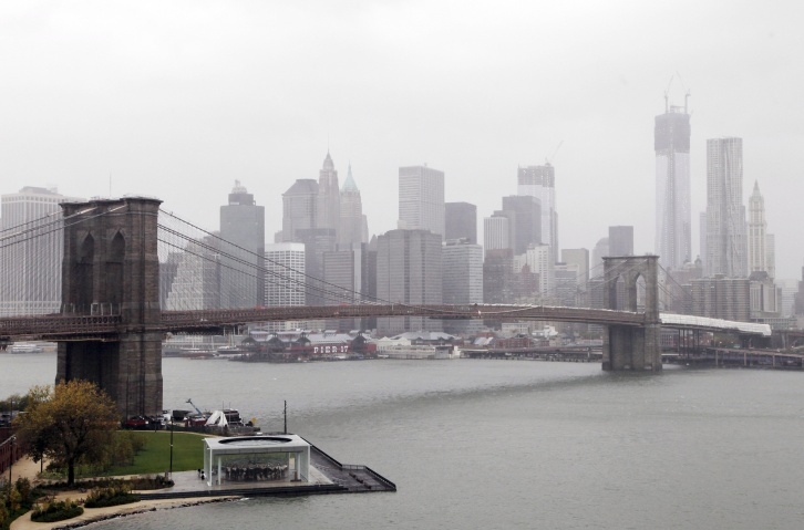 Rain and wind pass over the Brooklyn Bridge and the New York skyline as Hurricane Sandy advances on the city, Monday, Oct. 29, 2012. — AP Photo