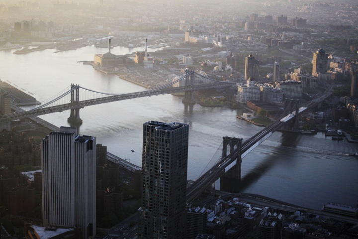 The view of the Manhattan Bridge, left, and Brooklyn Bridge as seen from the 105th floor of One World Trade Center, Friday, May 10, 2013 in New York. — AP Photo