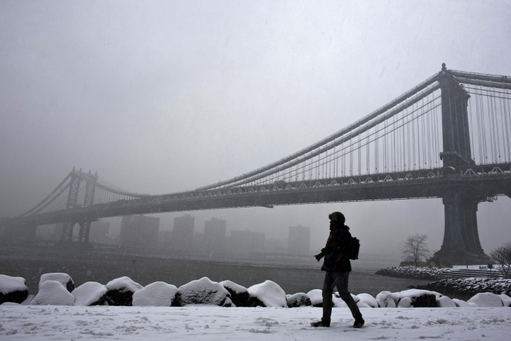 A man walks through Brooklyn Bridge Park during a snowstorm in New York, March 8, 2013. — Reuters Photo