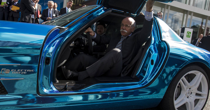 Dieter Zetsche, CEO of German carmaker Daimler, arrives in a Mercedes SLS Electric Drive at the Electro Mobiliy Conference of the German Government in Berlin May 27, 2013. — Reuters Photo