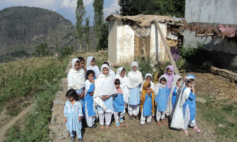 Students standing outside of a destroyed school in Saar village of Charbagh, Swat. — Photos by author.