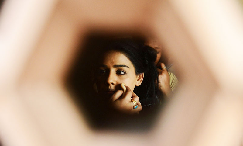 "Female Pakistani drama artist Yasmin Huq has her makeup done prior to shooting a scene in the play ""Taan"". —AFP Photo"