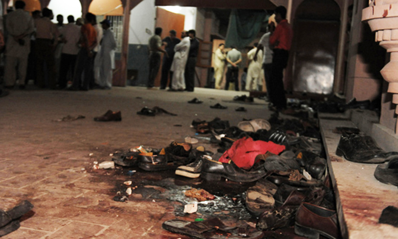 The photo shows Pakistani Ahmadi community members gathering at their worship place after a suicide attack in Lahore on May 28, 2010. — AFP/File photo