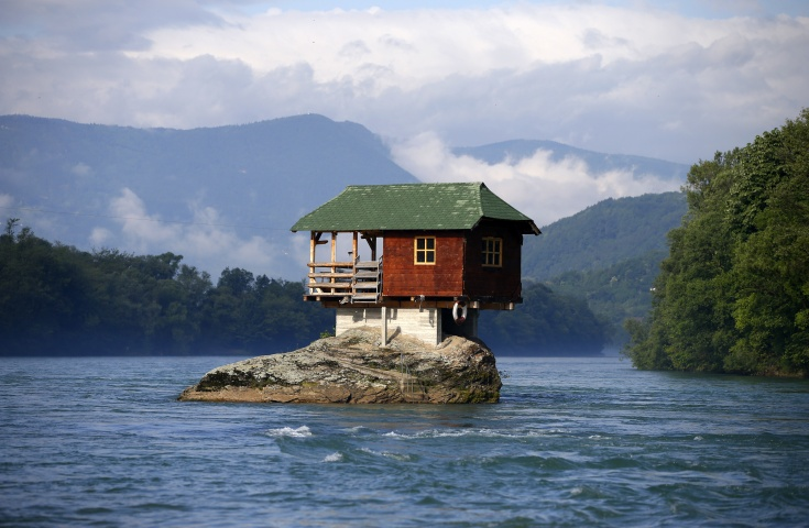 A house built on a rock on the river Drina is seen near the western Serbian town of Bajina Basta, about 160km (99 miles) from the capital Belgrade May 22, 2013. The house was built in 1968 by a group of young men who decided that the rock on the river was an ideal place for a tiny shelter, according to the house's co-owner, who was among those involved in its construction.