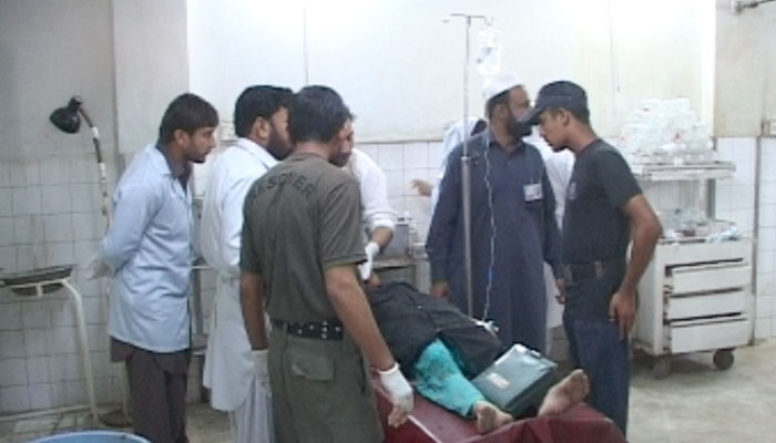 An injured polio worker is being treated at Lady Reading Hospital in Peshawar on Tuesday. – Photo by Zahir Shah Sherazi