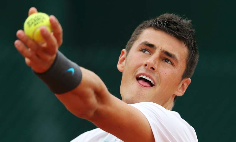 Bernard Tomic of Australia serves to Victor Hanescu of Romania during their men's singles match at the French Open tennis tournament at the Roland Garros stadium in Paris.-Reuters Photo