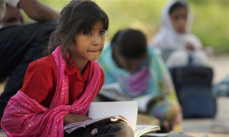 A girl attends a class at a makeshift school in Islamabad. — Photo by AP