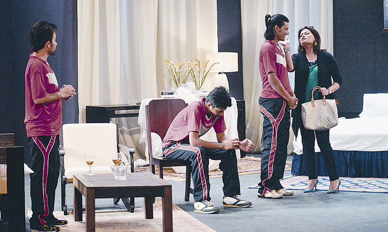 Davos Intizar (Bakhtawar Mazhar) acts cheeky with Chicu (Sunil Shankar) while Sam (Hammad Khan)  waits for the conversation to end in the chair and Fani (Rauf Afridi) looks on.–Photo by White Star