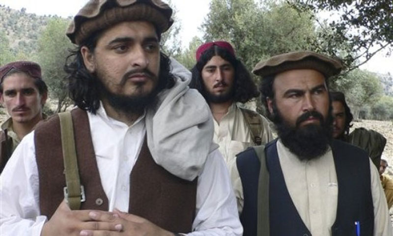 In this photo taken on October 4, 2009, new Pakistani Taliban chief Hakimullah Mehsud, left, is seen with Waliur Rehman during his meeting with media in South Waziristan's Sararogha area. — Photo by AP/File
