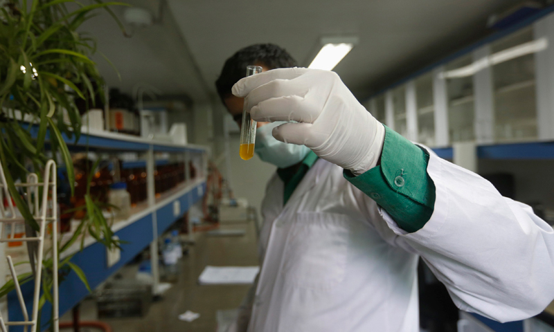 An Afghan pharmacist analyses samples of drugs, at a laboratory under the Interior Ministry's Counter Narcotics, in Kabul May 26, 2013. Impoverished Afghanistan, already plagued by insurgency and struggling to contain crippling rates of opium addiction, faces another potential headache with spiralling usage of the synthetic drug crystal methamphetamine. — Reuters Photo