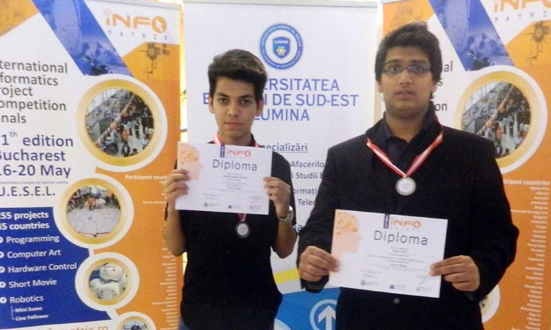 PakTurk students with medals and certificates earned in the International Computer Projects Competition held in Romania.