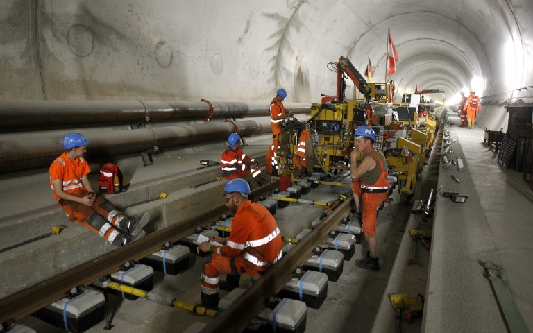 Workers have a break during the installation of the railway tracks in the Neat Gotthard Base tunnel near Erstfeld May 7, 2012