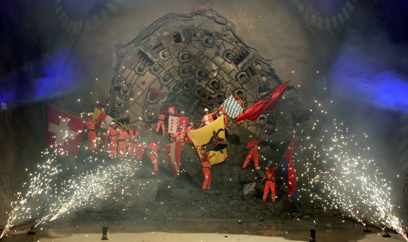 Miners celebrate as fireworks explode after a giant drill machine broke through the rock at the final section Sedrun-Faido, at the construction site of the Neat Gotthard Base Tunnel March 23, 2011.