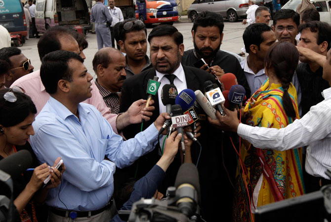 Prosecutor Chaudhry Zulfikar talks to journalists outside the anti-terrorism court (ATC) in Rawalpindi, in this file picture taken April 26, 2013. — Reuters Photo
