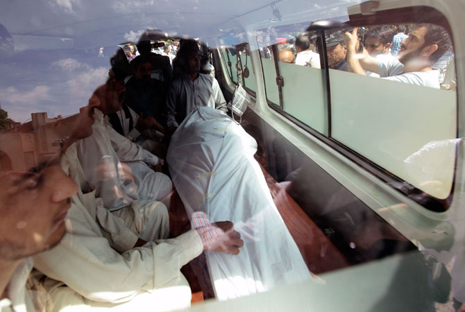 The body of Zulfikar is seen through an ambulance window. — Reuters Photo