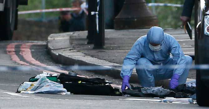 This photo shows a police forensics officer investigating the crime scene where a soldier was killed in Woolwich, southeast London.—Reuters Photo