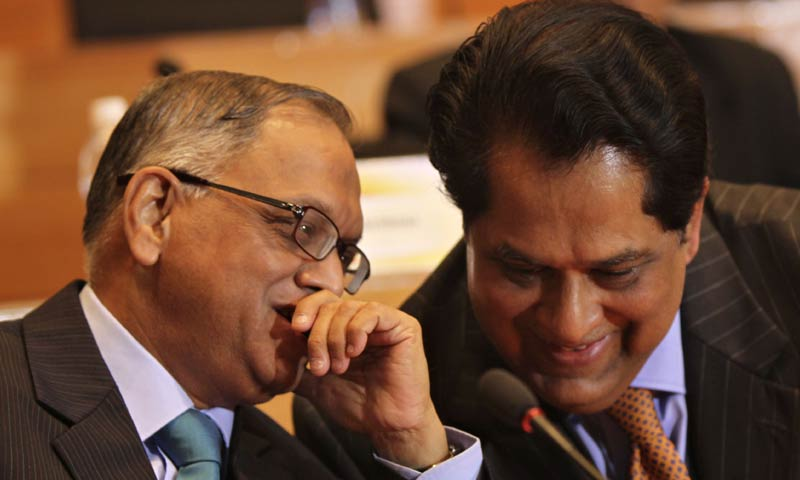 In this photograph taken on April 30, 2011, then-outgoing chairman and founder of Infosys Technologies N.R. Narayana Murthy (L) talks with then-newly appointed chairman K.V. Kamath in Bangalore. - AFP File Photo