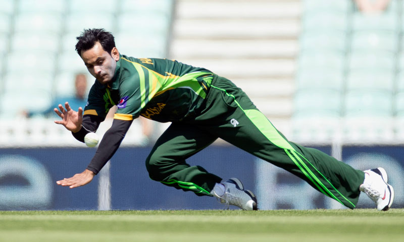 Pakistan's Mohammad Hafeez fields the ball after pitching a delivery — AP Photo