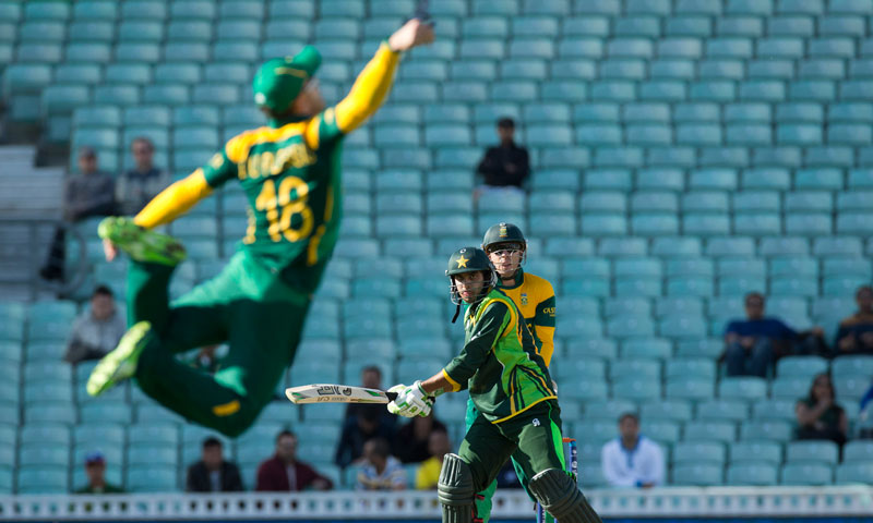 South Africa's Francois du Plessis dives to field the ball off a shot from Pakistan's Umar Amin — AP Photo