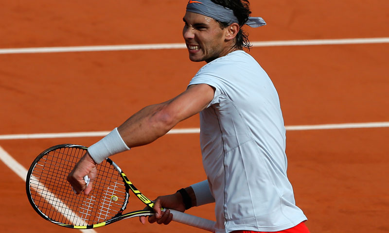 Defending champion, Spain's Rafael Nadal celebrates as he defeats Japan's Kei Nishikori during their fourth round match of the French Open tennis tournament at the Roland Garros stadium Monday, June 3, 2013 in Paris. Nadal won 6-4, 6-1, 6-3. — AP Photo
